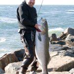 Warren Denningtonwith 50lb bass on Montauk Point