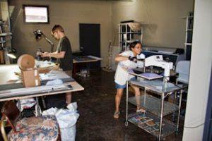Marcela & Dan working in the Studio