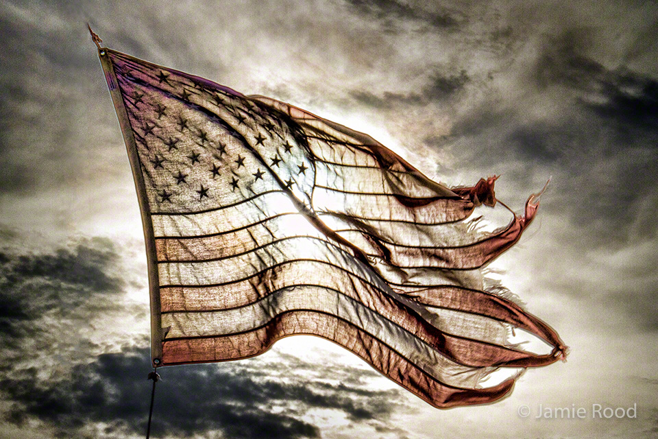 Tattered American Flag Unity in all we've been through...
